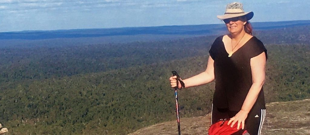 Lady happy to reach top of Mt Cuthbert during a Didier Walks overnight hike
